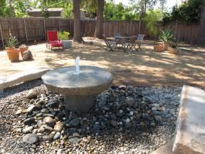 granite millstone water feature and seating area on