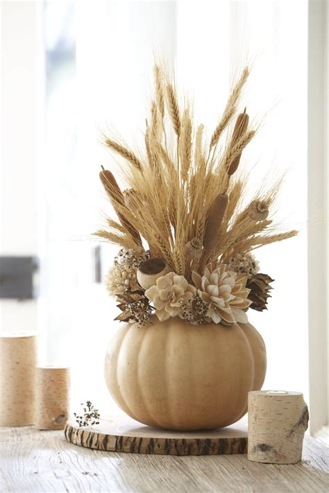 fall centerpieces with feathers 65 awesome pumpkin centerpieces for fall and halloween table digsdigs