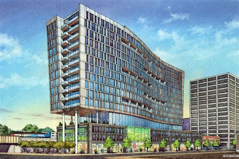 wavy high rise apartment tower pitched  downtown