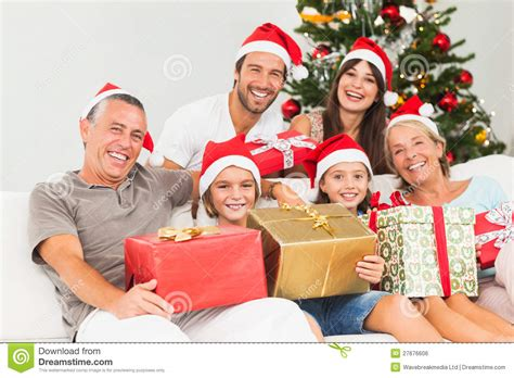 happy family at christmas holding gifts stock photo