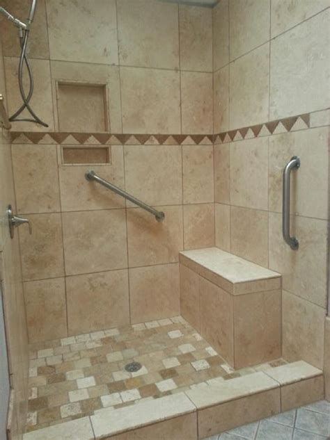 18x18 tile in small bathroom 18x18 travertine tile on walls 4x4 tumbled marble tiles on floor soap cubbies bench