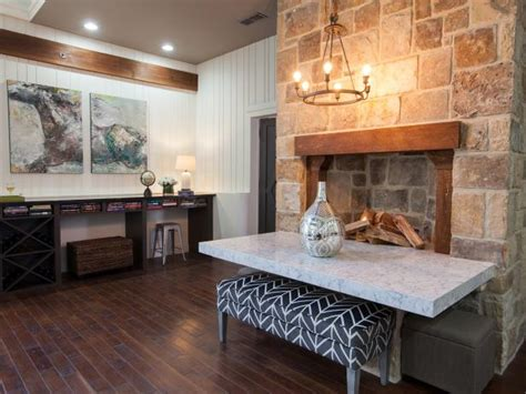 rustic neutral great room  stone fireplace hgtv