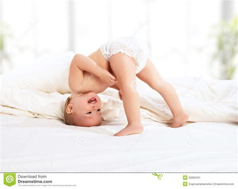 how to roleplay in bed happy baby child playing in bed stock image image 35663401