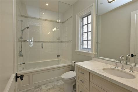 Seamless Glass Shower Door Pricey Pads Chic Guest Bathroom With Seamless Glass Shower Door With Wood Paneled