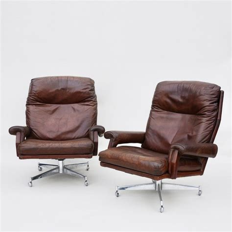 pair of leather swivel chairs armchairs seating apollo