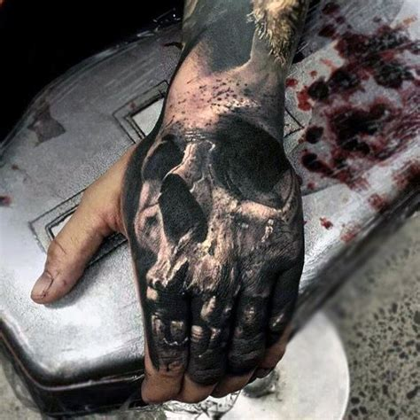 skull tattoo on hand meaning 80 skull hand tattoo designs for men manly ink ideas