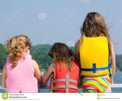 girl on front of boat three girls on front of boat royalty free stock image