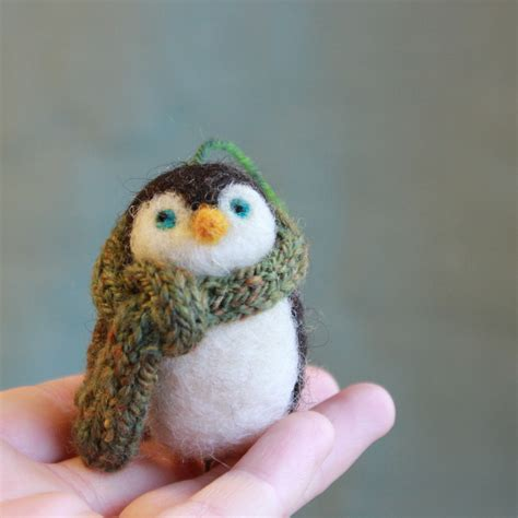 penguin christmas ornament in a handspun hand knit scarf