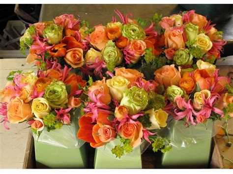 pink orange yellow and green reception wedding flowers