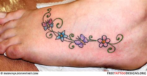 small flower foot tattoos foot tattoos