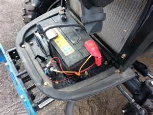 where is the fuse box located on a 3510 mahindra tractor