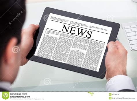 reading on tablet businessman reading news on digital tablet stock photo