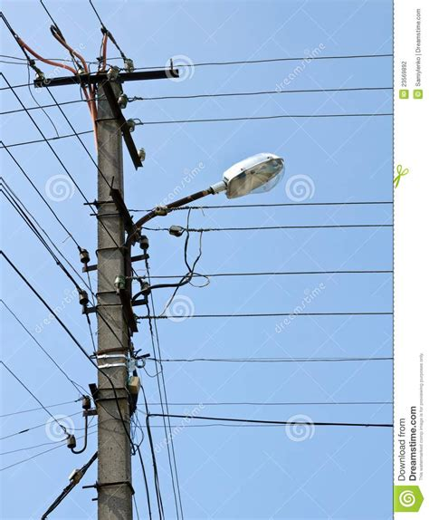 Pole With Electrical Lines And Street Light Stock