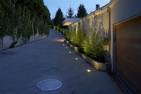 landscape lighting driveway extraordinary driveway lighting ideas with grass roofline detached garage