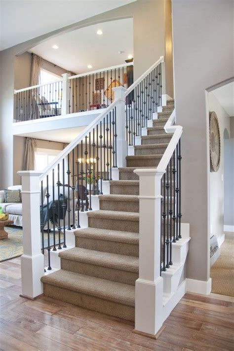 white banister rail open loft overlooking the living room decoration