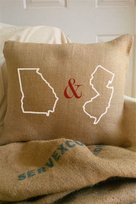 burlap state to state distance hearts pillow by