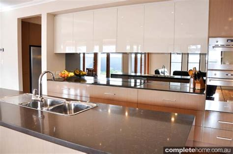 island bench rangehood the glamour of gloss streamlined kitchen completehome