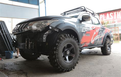 mitsubishi adventure modified mitsubishi triton takes on the borneo safari