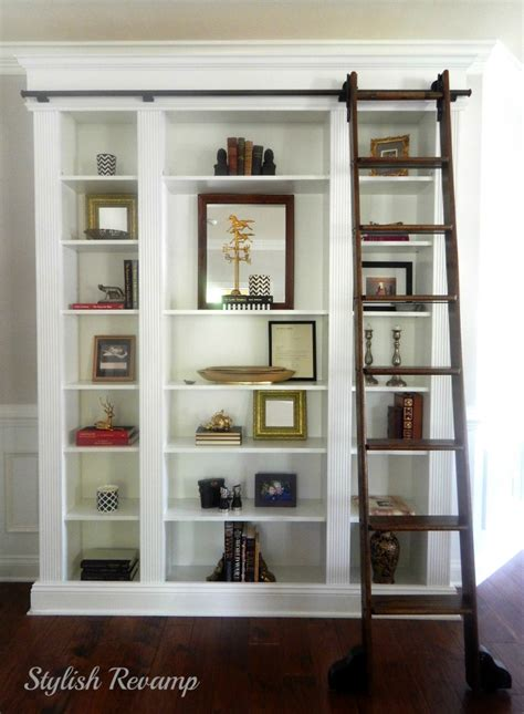 bookcase with rolling ladder changing paint colors from warm tones to cool tones