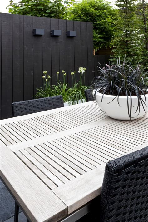 black and white patio furniture black fence and white table greenery beautiful back
