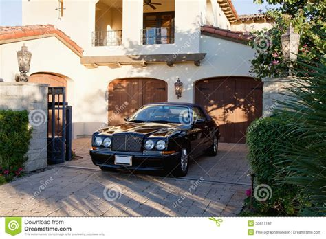 House And Cars by Luxurious Car Parked In Entrance Gate Of House Royalty