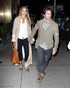Elizabeth Berkley holds hands with husband Greg Lauren on