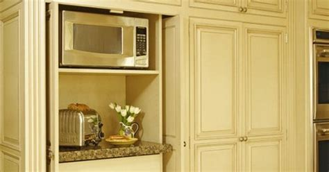 pocket doors to hide kitchen appliances a must in a dream appliance storage built into tall cabinet with pocket