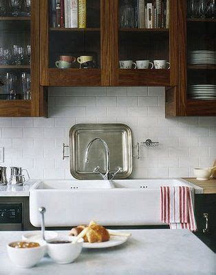 glass cabinet doors kitchen farmhouse with apron sink farmhouse sink wood window cabinets white tile