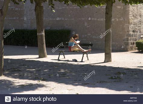 bench reading girl sitting alone on bench reading www pixshark com