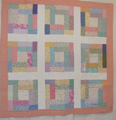 crib size baby quilt in multi colored pastels
