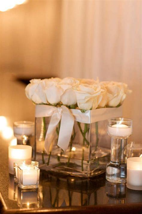 square vases with all white roses make a beautiful wedding