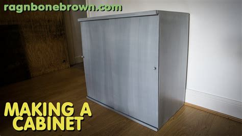 a cabinet with sliding doors