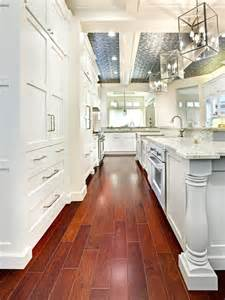 How To Organize A Large Kitchen - white shaker kitchen cabinets dark wood floors modern wood interior home design kitchen