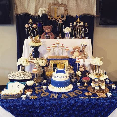 royal theme baby shower prince cake with crown royal blue and gold candy buffet table