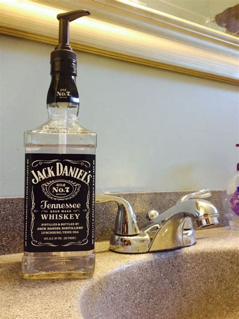 jack daniels bathroom turned this jack daniels bottle into a soap dispenser for