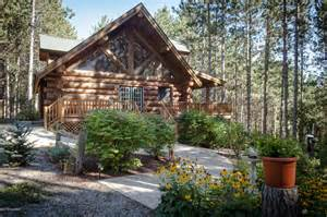 stunning log home nestled in the woods on 30 acres just