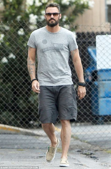 brian austin green tattoos brian green shows his tattoos in a grey top as