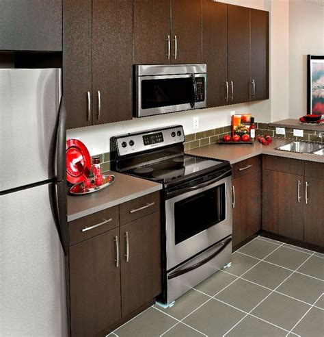 brown kitchen appliances 35 best we create kitchens images on pinterest calgary