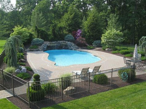 landscape around pool traditional swimming pool with fence exterior brick