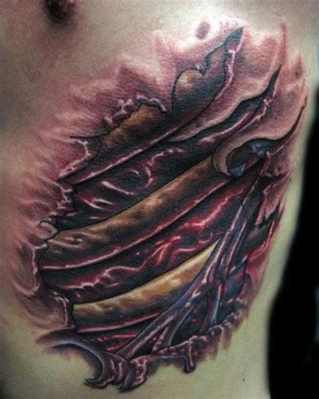 christian rib tattoo by christian perez tattoonow