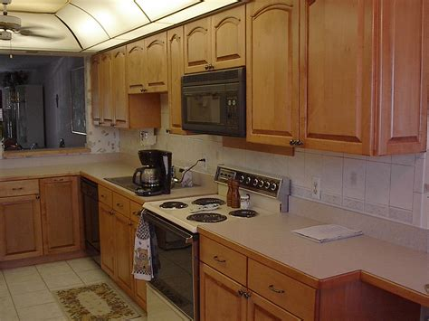stained kitchen cabinets painted vs stained kitchen cabinets all about house design