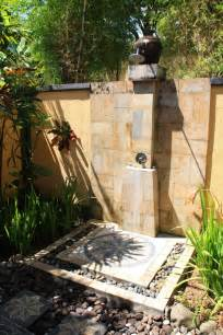 wonderful outdoor shower stand design with stone floor ideas and concrete fence outside bathroom you have idea before