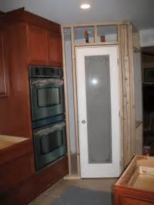 corner pantry framed out and door cled in kitchen