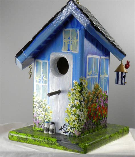 Decorative Birdhouses by Twisted Birdhouse Painted Blue With It S Own Bird