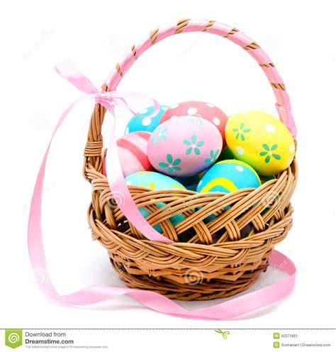 Handmade Easter - colorful handmade easter eggs in the basket isolated stock