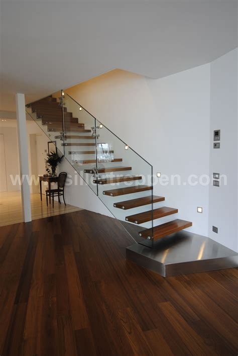 Floating Concrete Stairs And Landing modern floating stair with structural glass railing wood treads and stainless steel landing