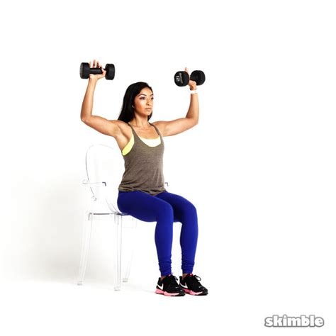 seated dumbbell bench press seated dumbbell press exercise how to workout trainer