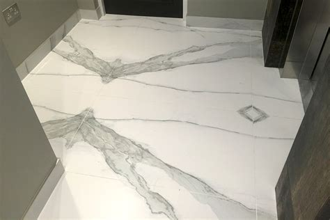 Beautiful Stairs tiling magic creates stunning marble effect staircase