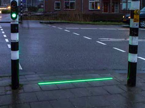 smartphone light town puts traffic lights in pavements for smartphone