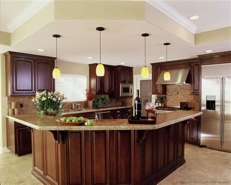 luxury kitchen island a luxury kitchen with cherry cabinets and a large angular